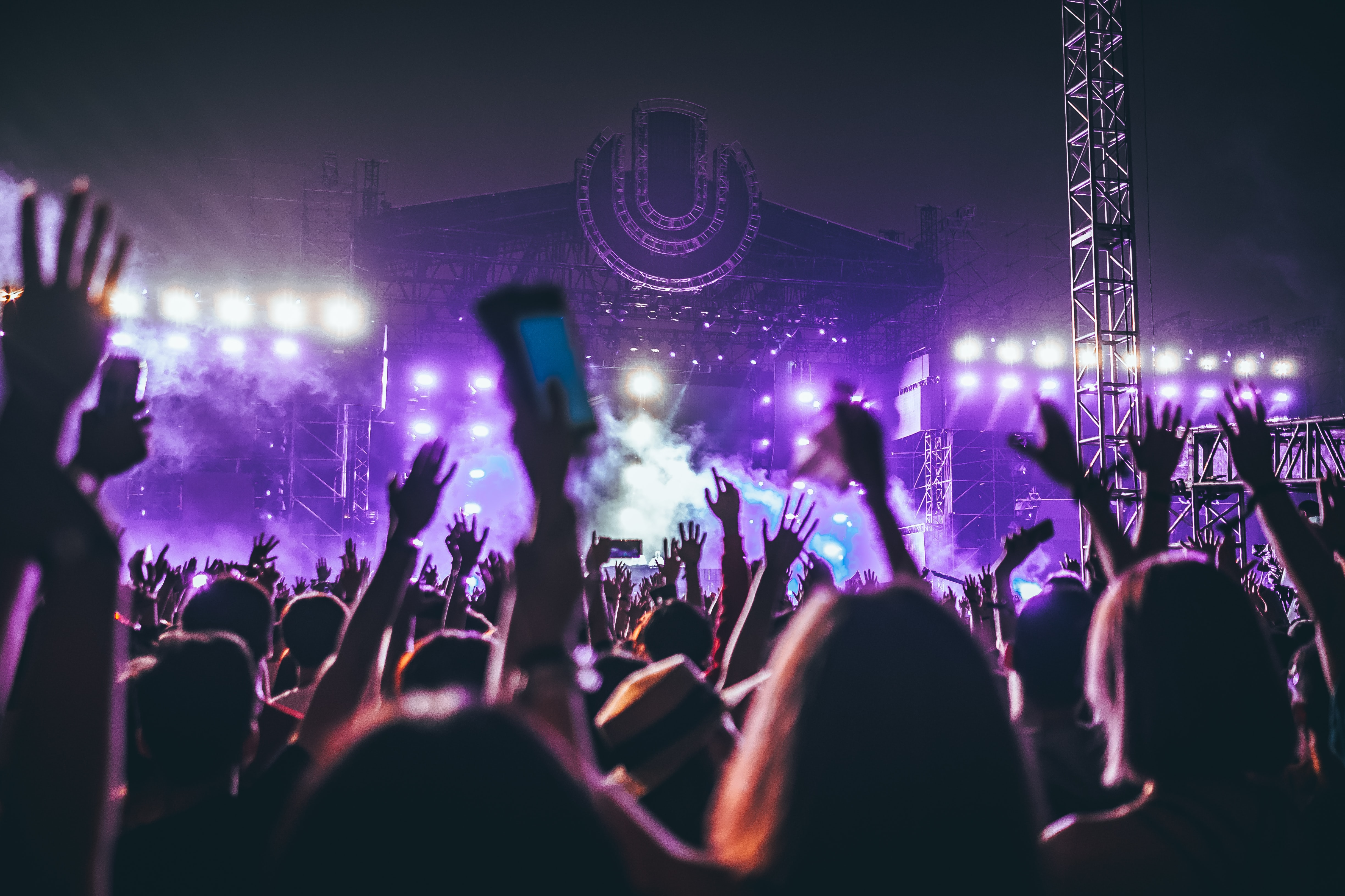 group of people raising there hands in concert