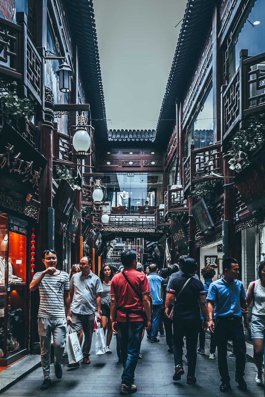 group of people between buildings