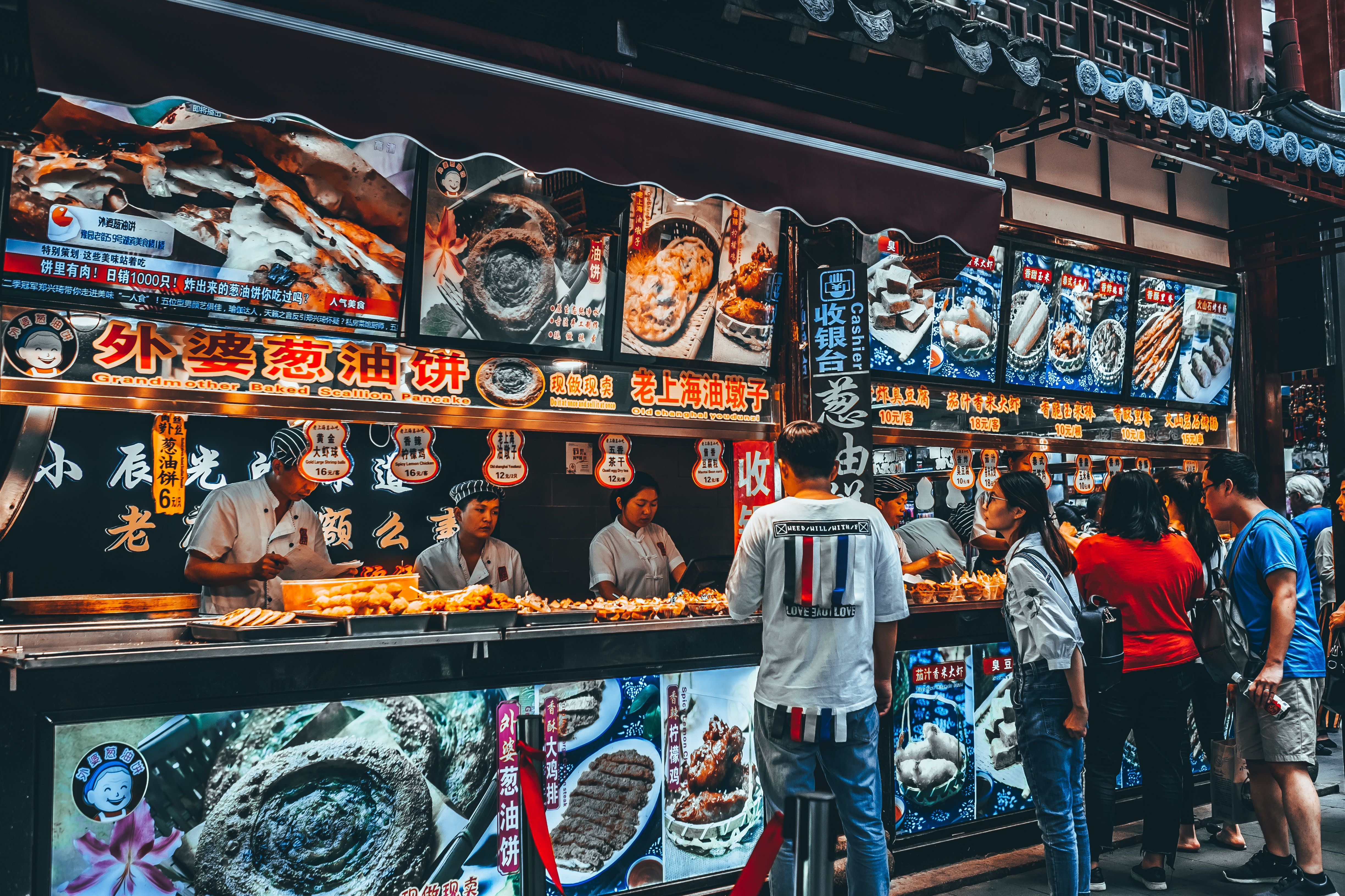 group of people buying food on food stall