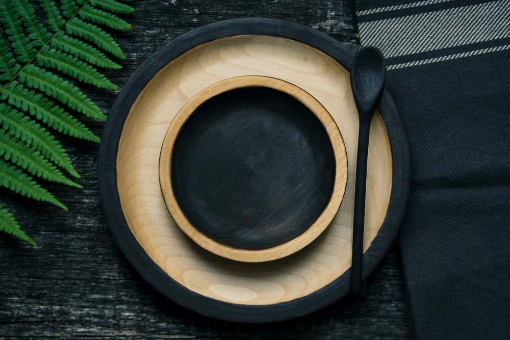 brown and black wooden bowl and plate