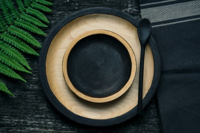 brown and black wooden bowl and plate plate teams background