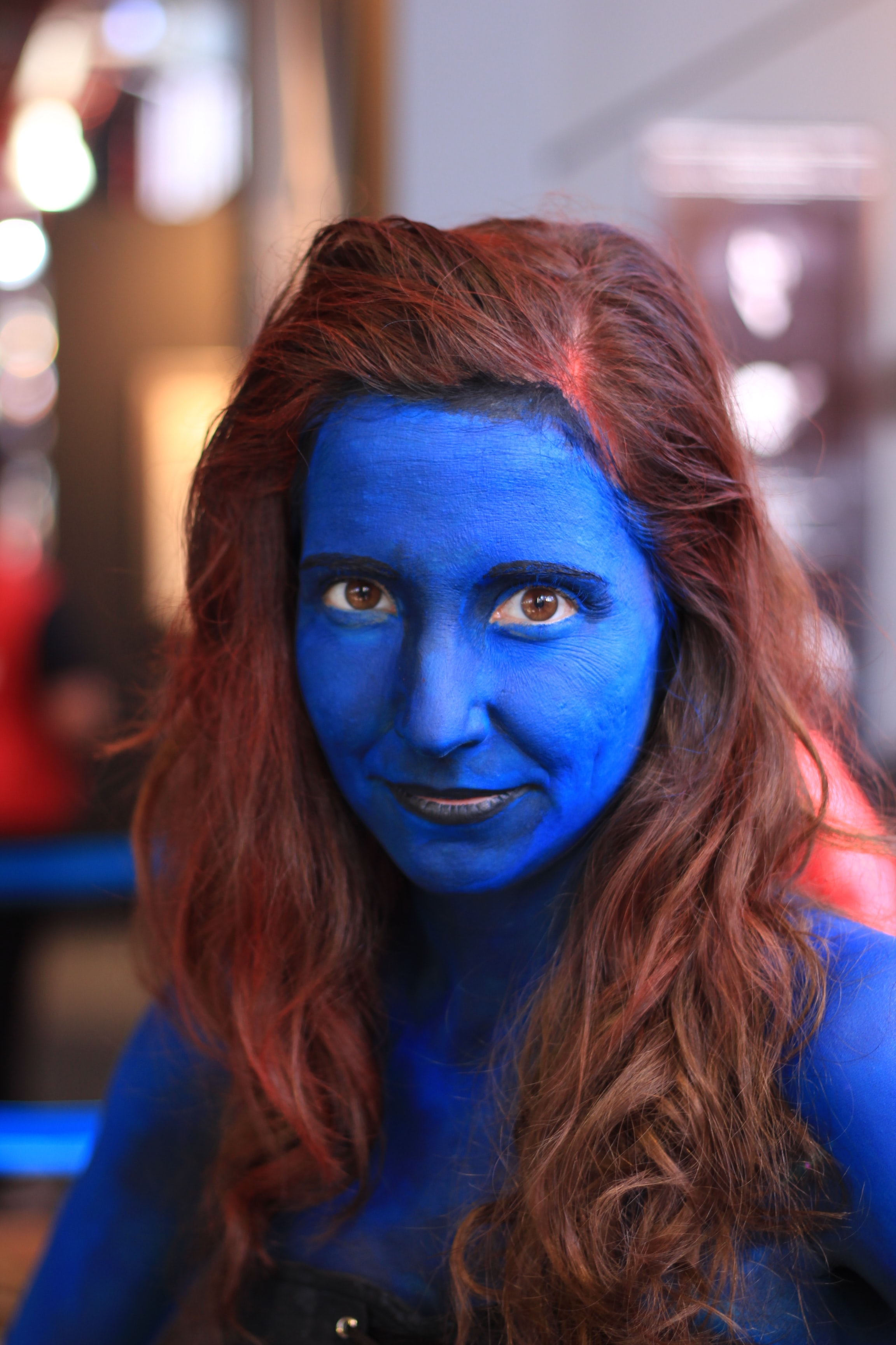 woman with blue bodypaint in selective focus photography