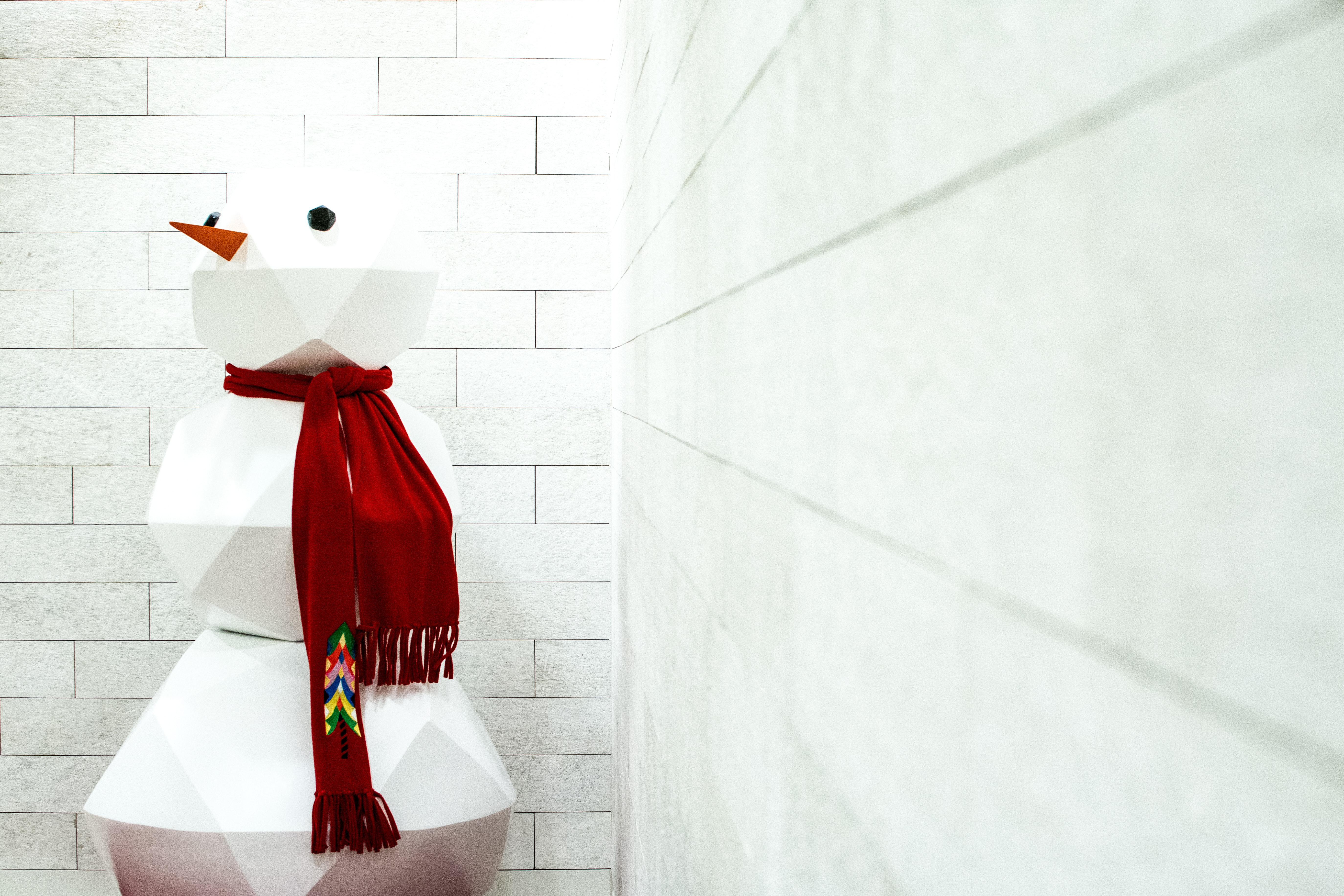 snowman Christmas decor at the corner of the wall
