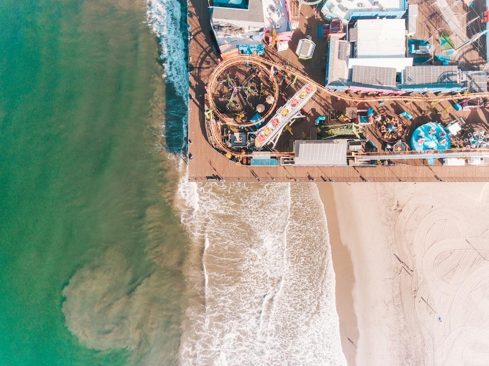 aerial photo of amusement park near bay