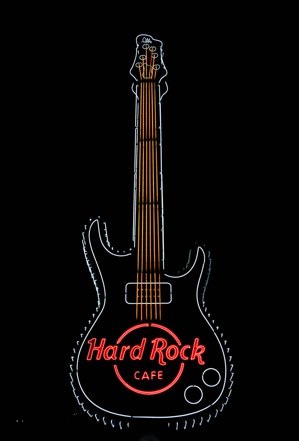 black and red electric guitar hard rock cafe signage