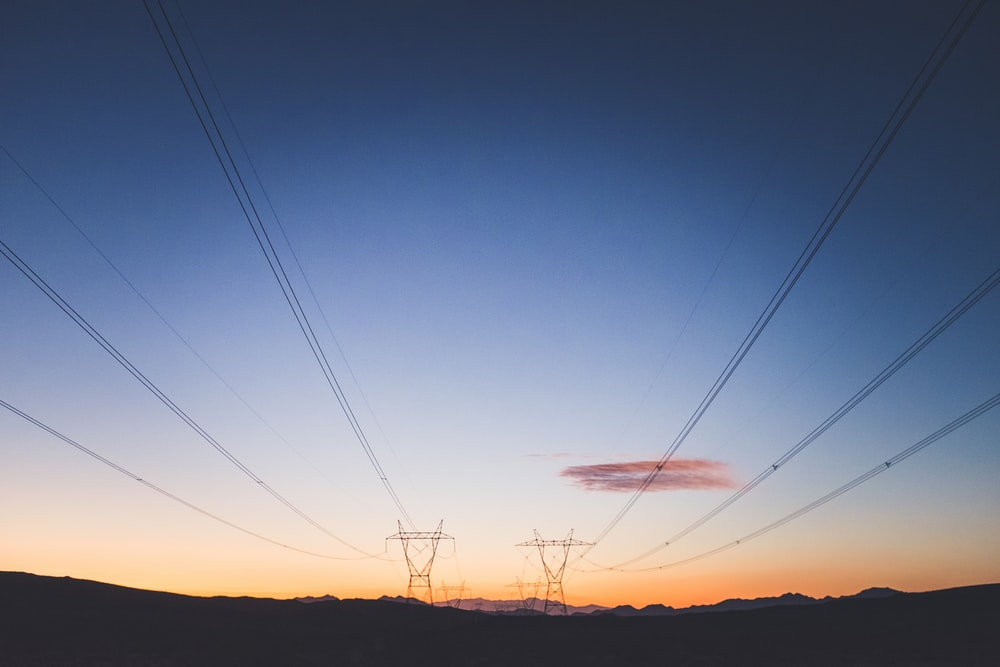 two transmission towers during golden hour