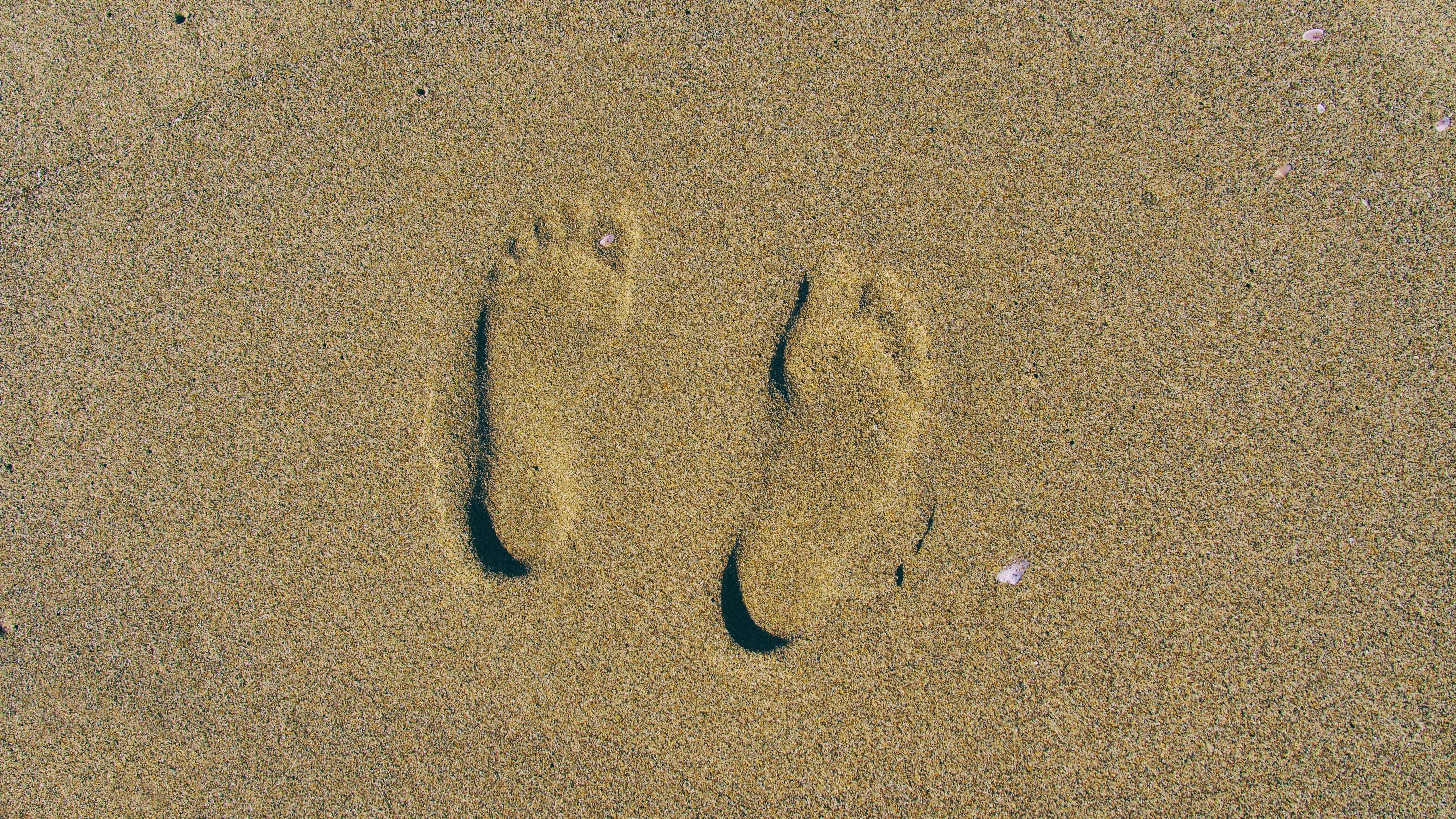 person's foot print on brown sands