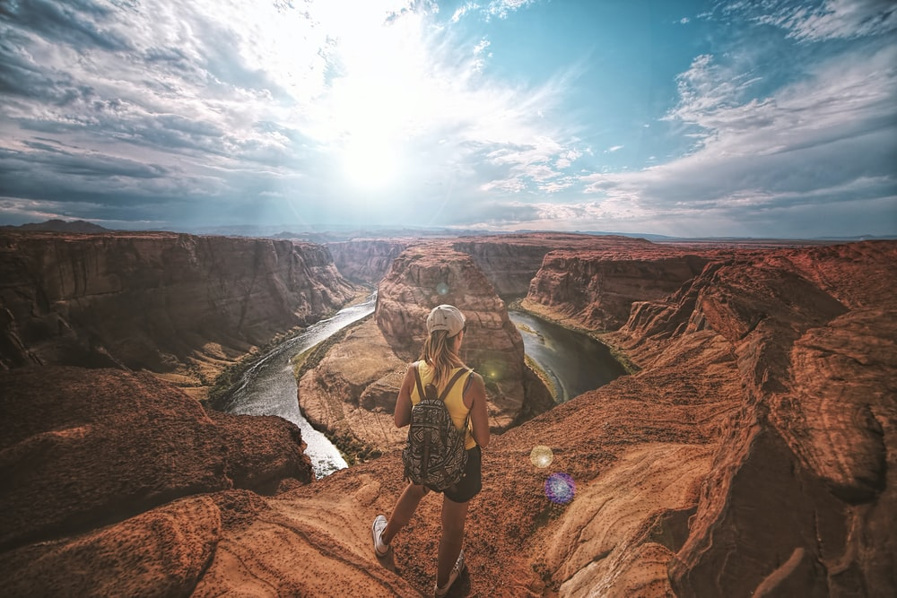 woman standing on top of canyon