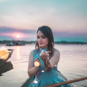 woman sitting on boat during sunset