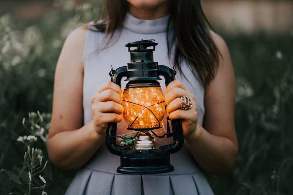 woman holding a lantern