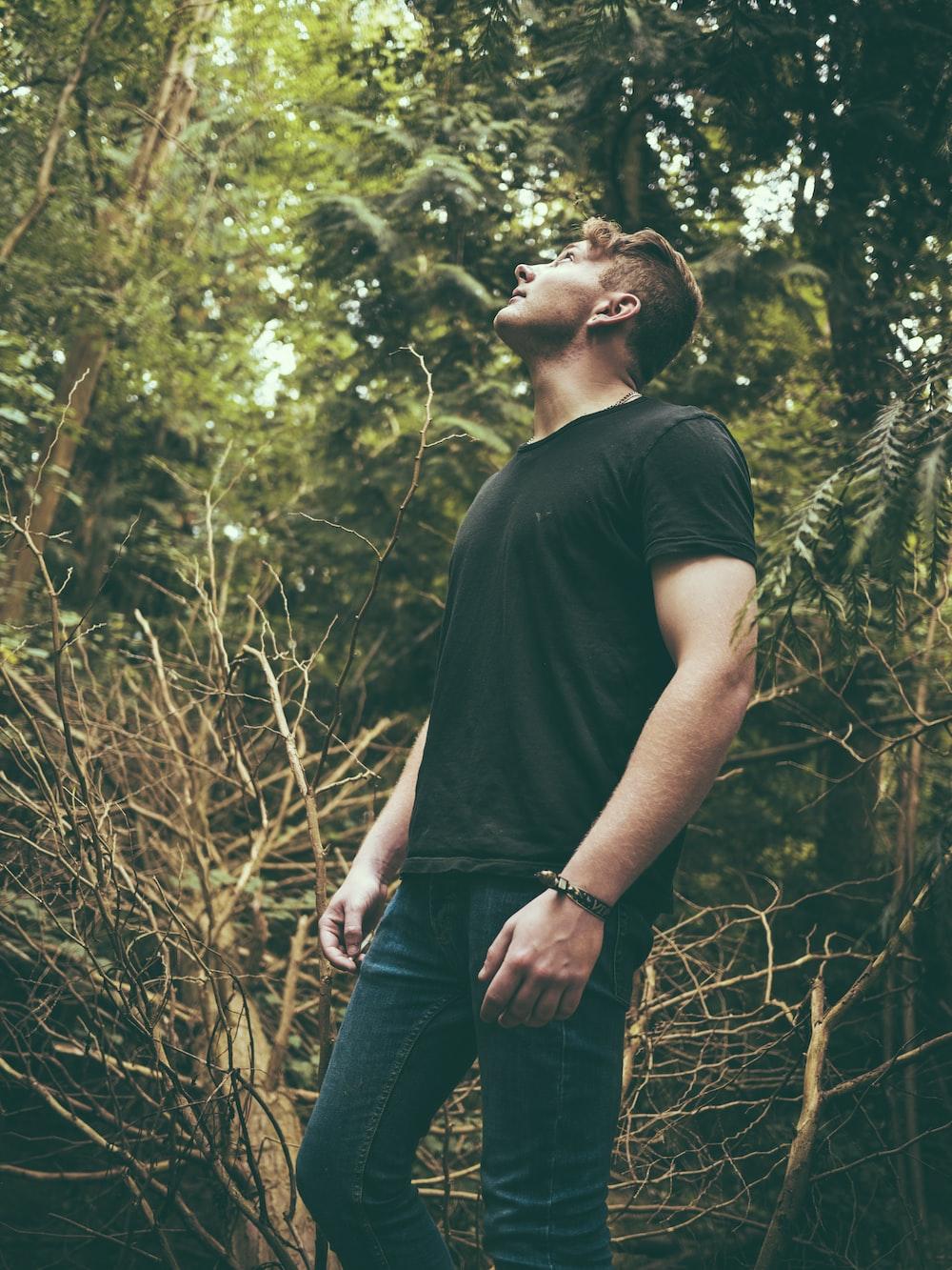 man standing near trees