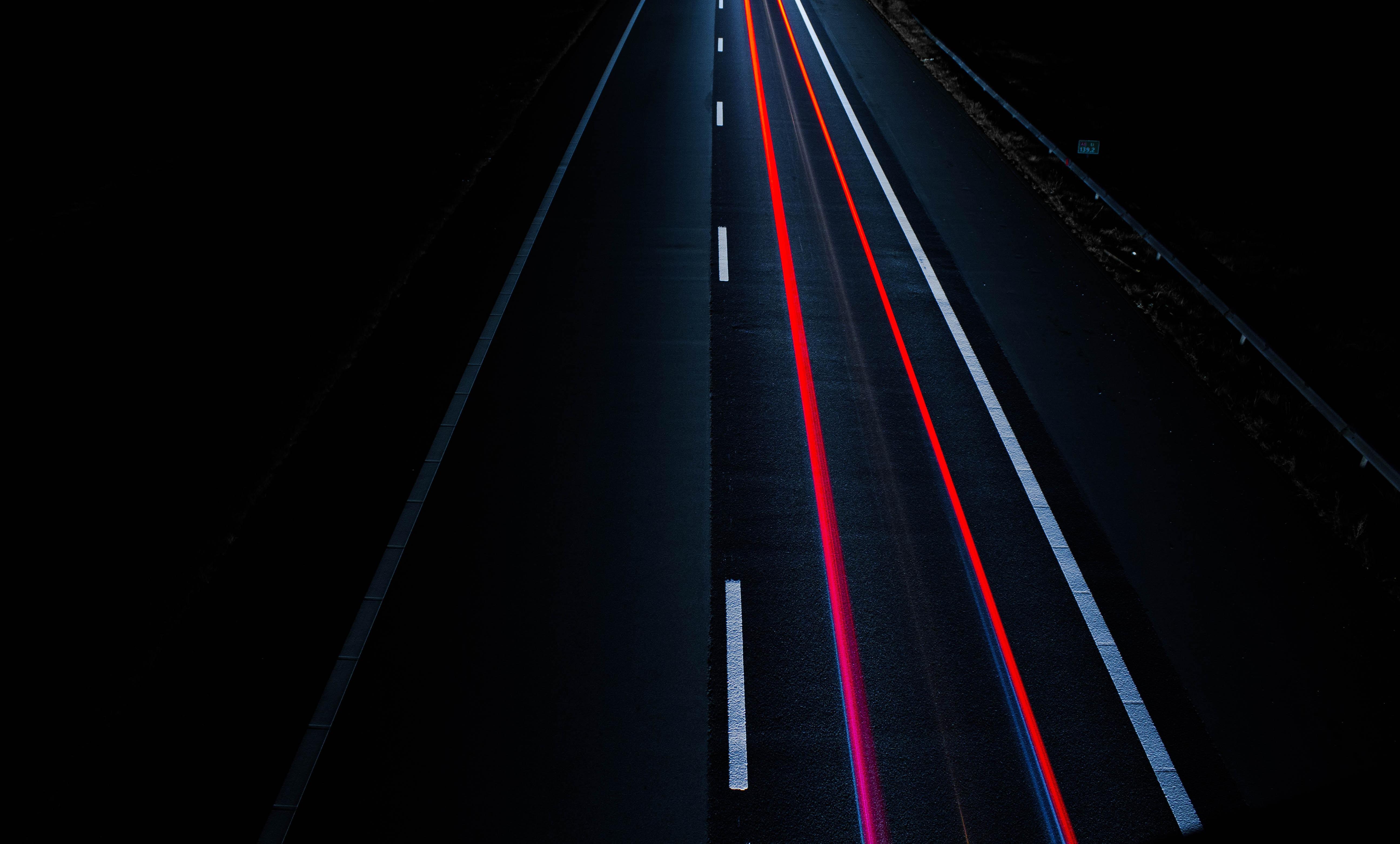 asphalt road with red line