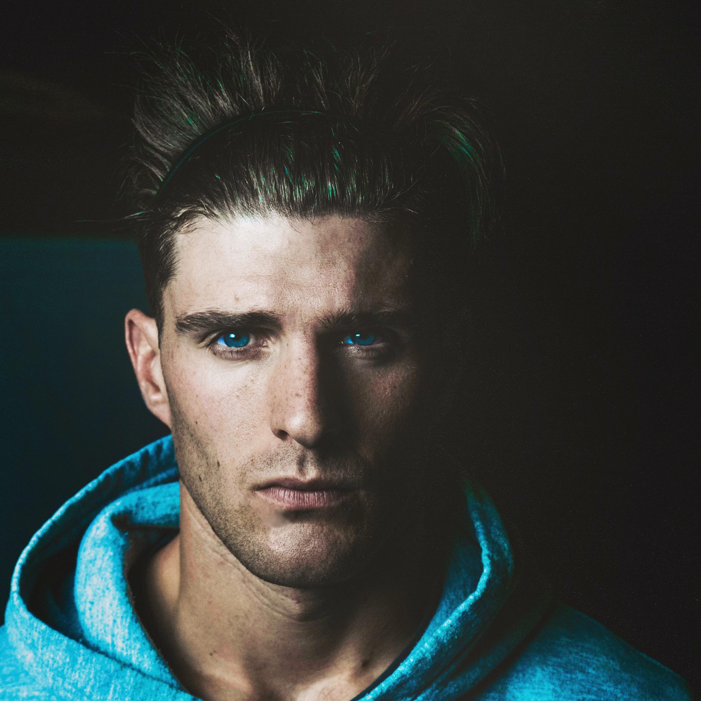 man wearing blue hoodie