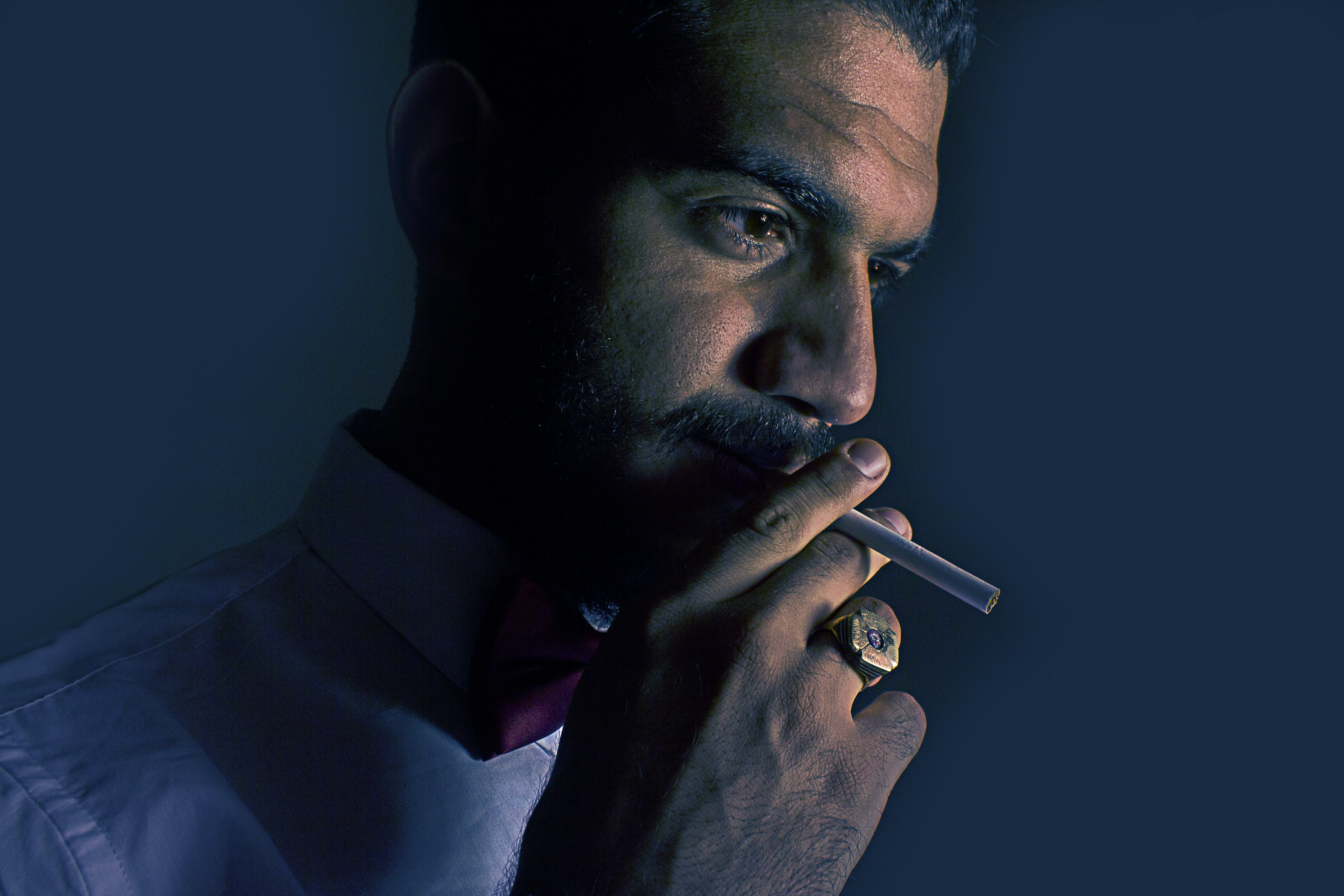 man holding cigarette stick