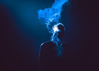 smoke coming out of person's mouth
