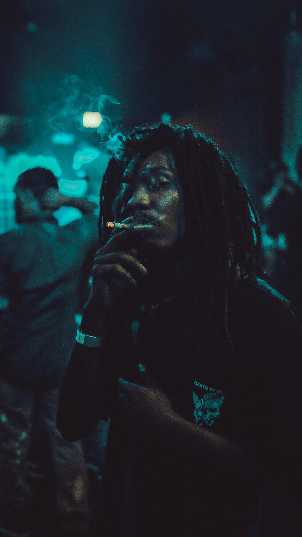 man using cigarette