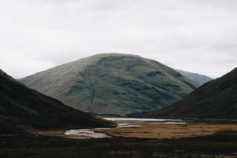 landscape photograph of river between hills