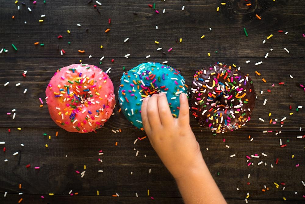 three sprinkled doughnuts