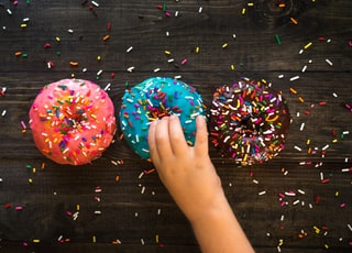 three sprinkled doughnuts