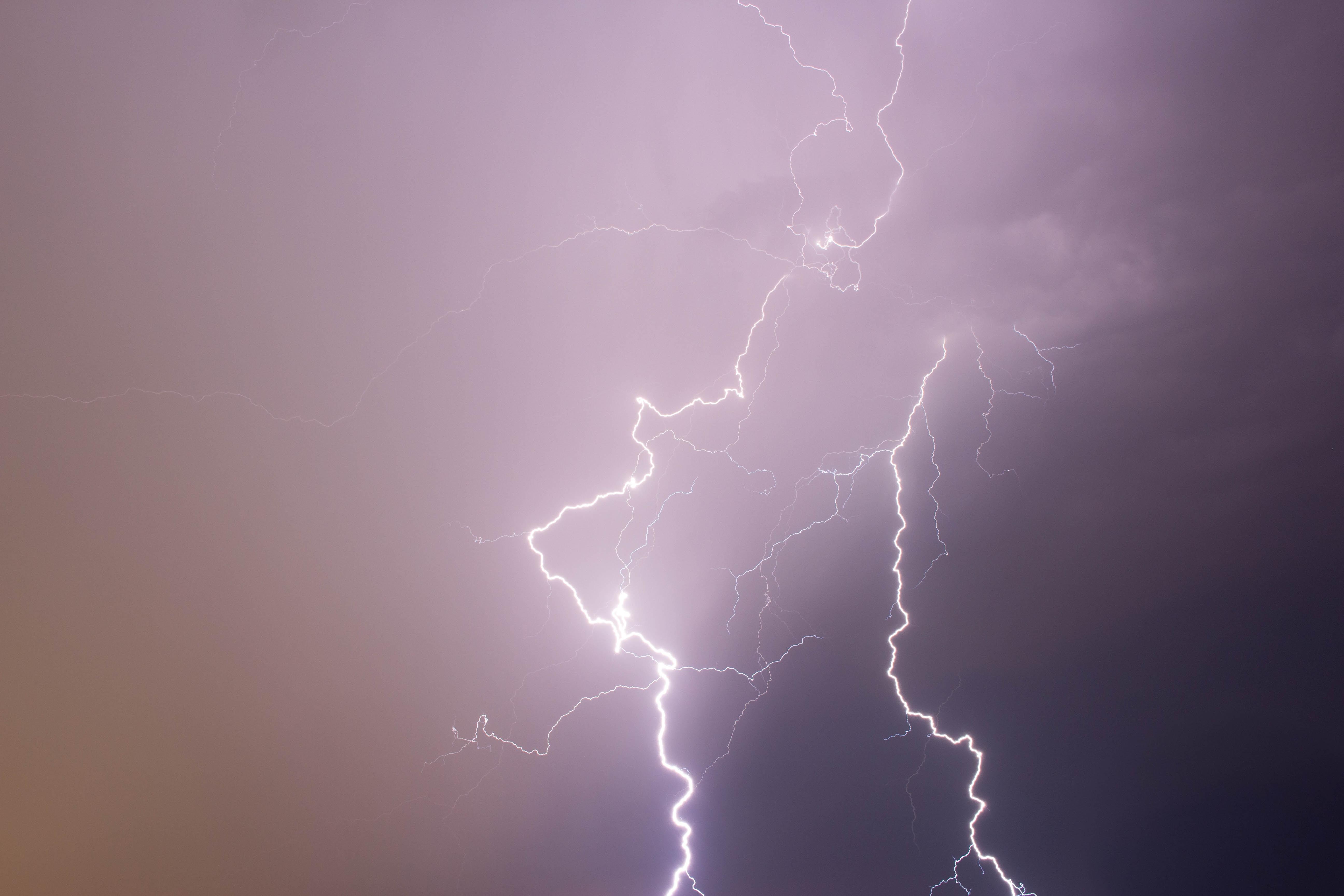lightning strikes under cloudy storm