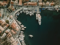 bird's eye view photography of body of water and cityscape
