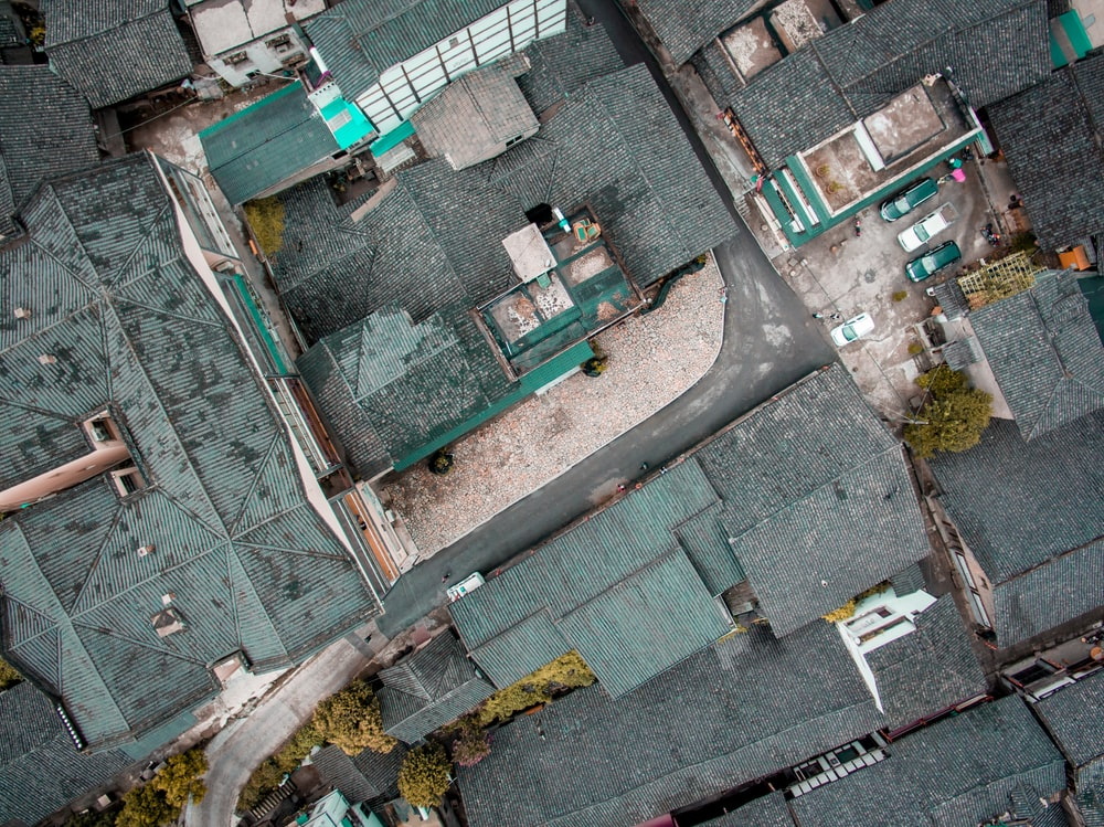aerial photography of gray roofed houses
