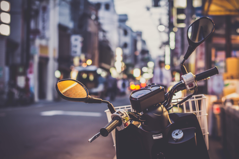 selective focus photograph of motorcycle handlebar