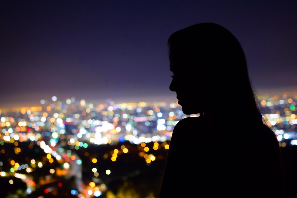 woman's silhouette in front of building