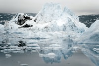 melted iceberg on body of water