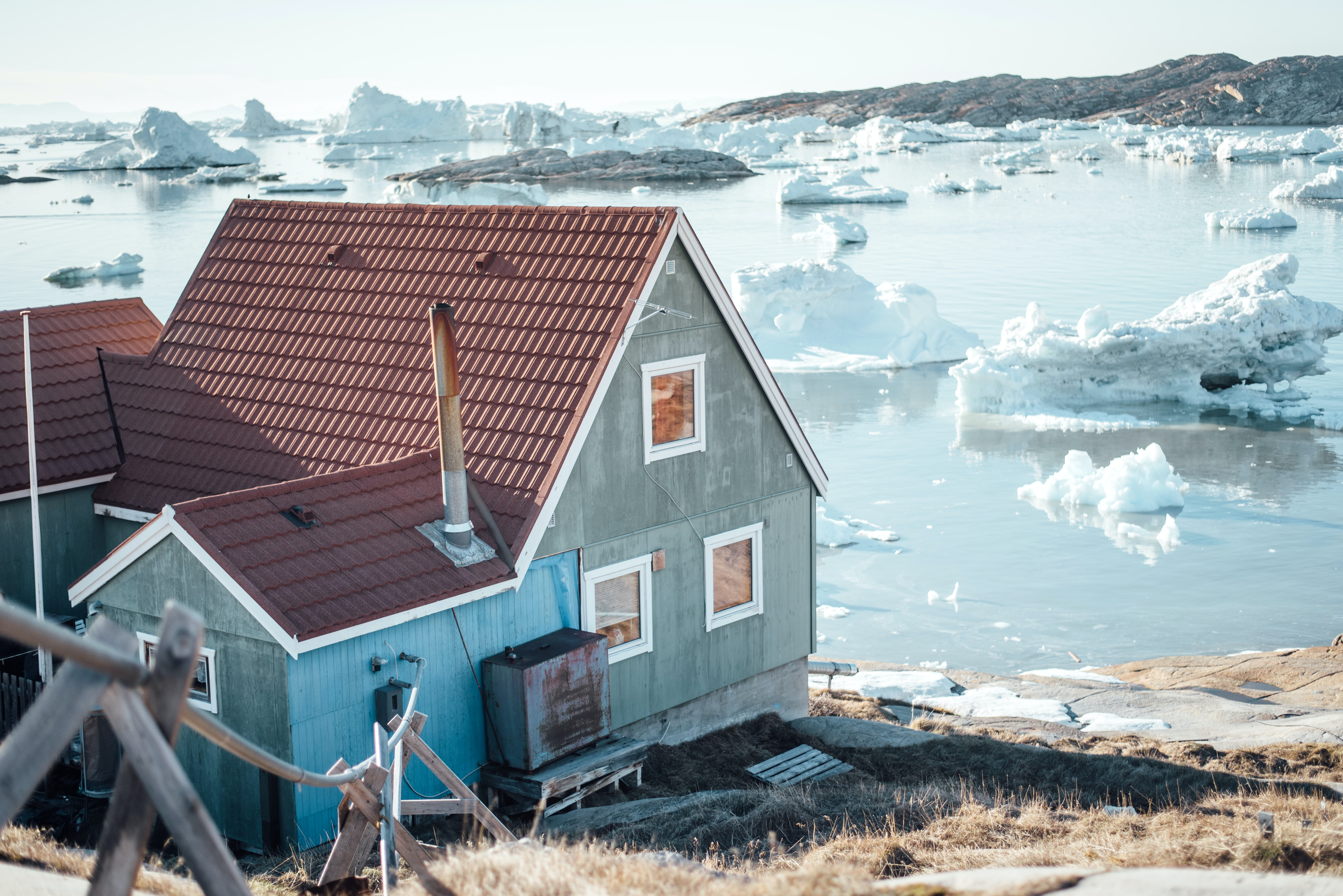 house beside body of water with icebergs