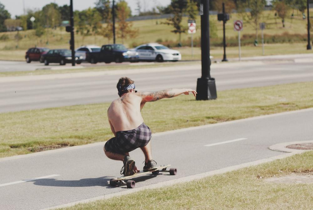 man riding longboard