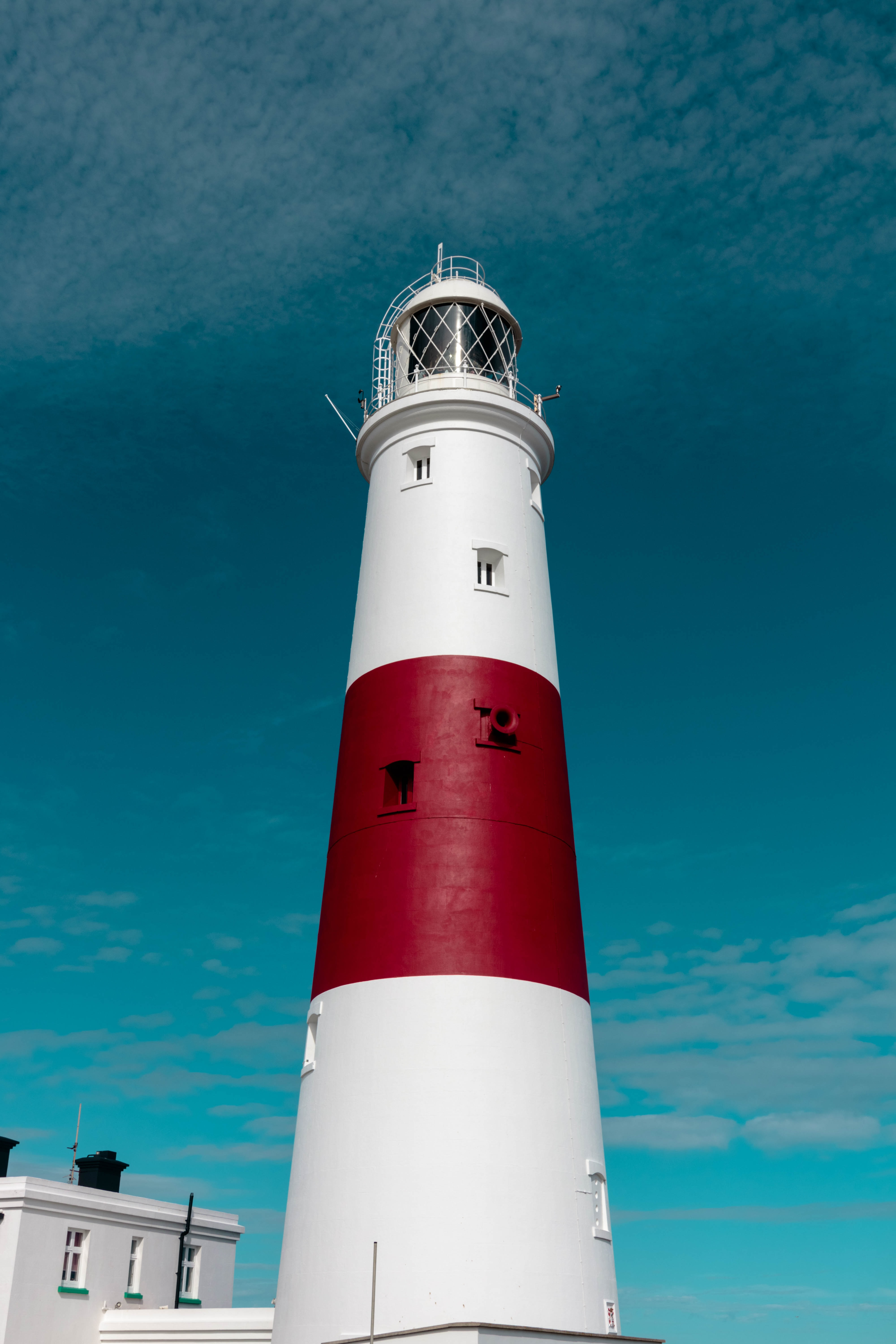 architectural photography of white and red lighthouse