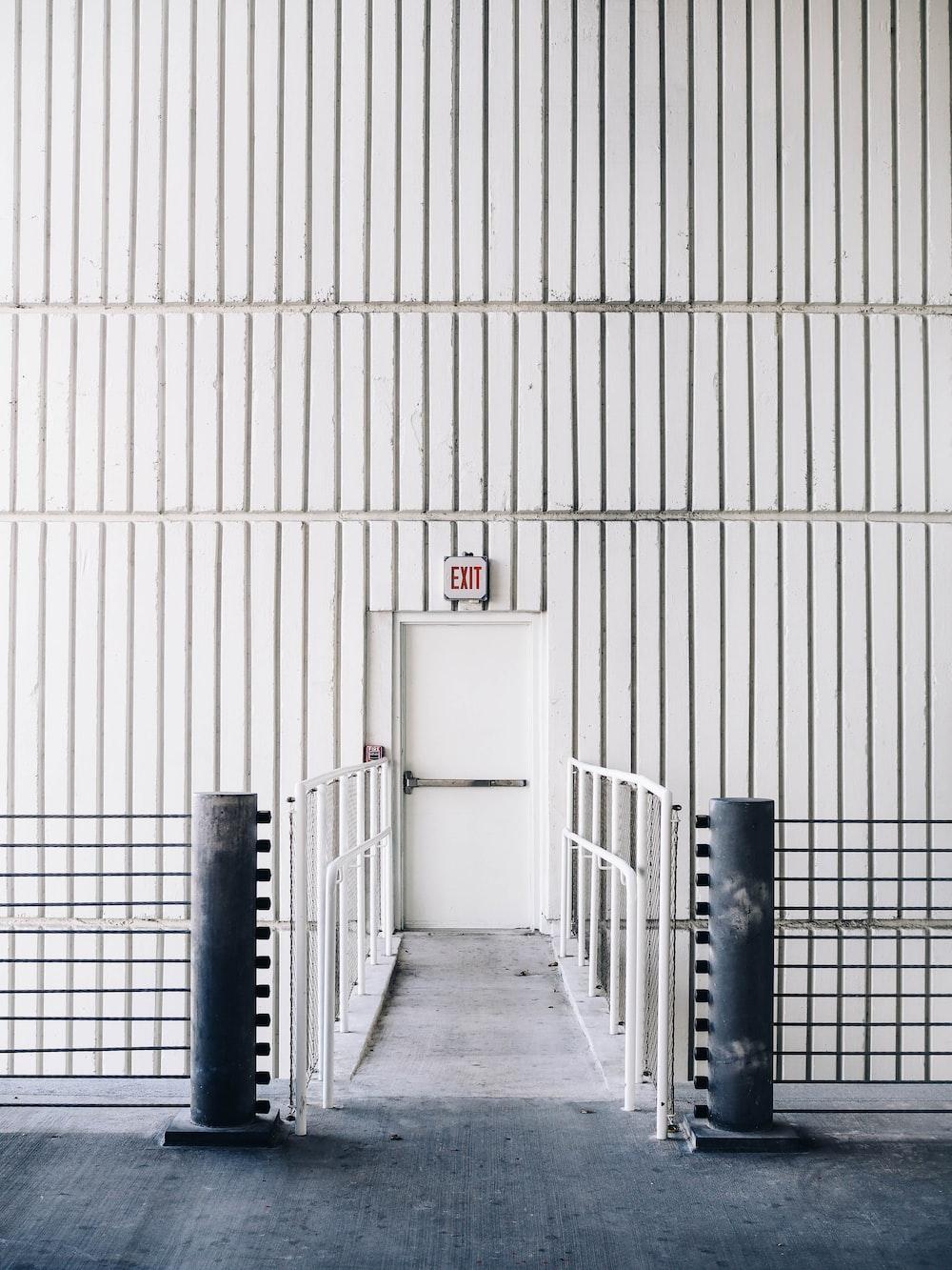 architectural photography of exit door with bridge