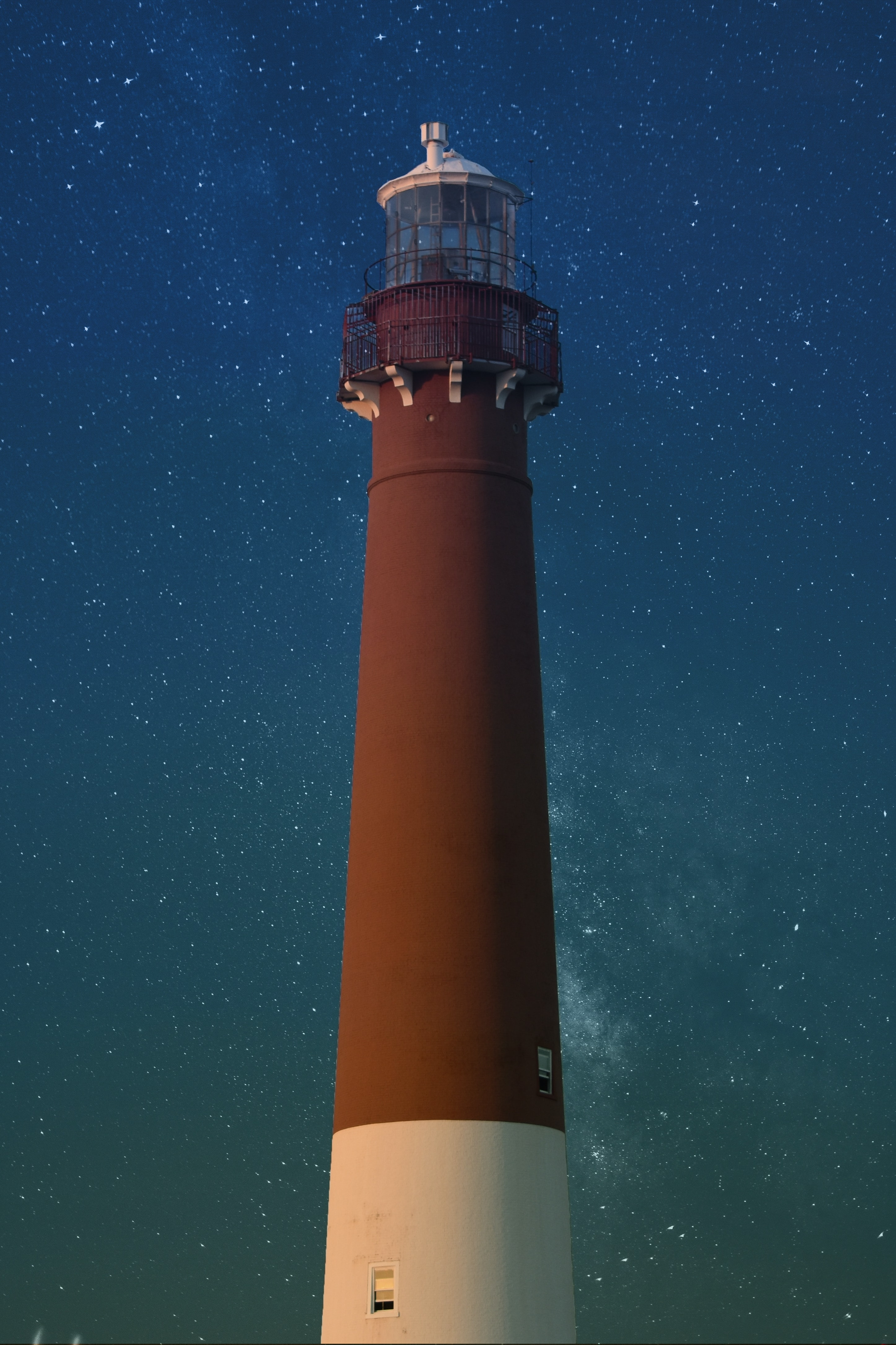brown and white lighthouse during nighttime