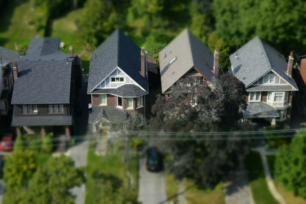 tilt-shift photography of house minitaure