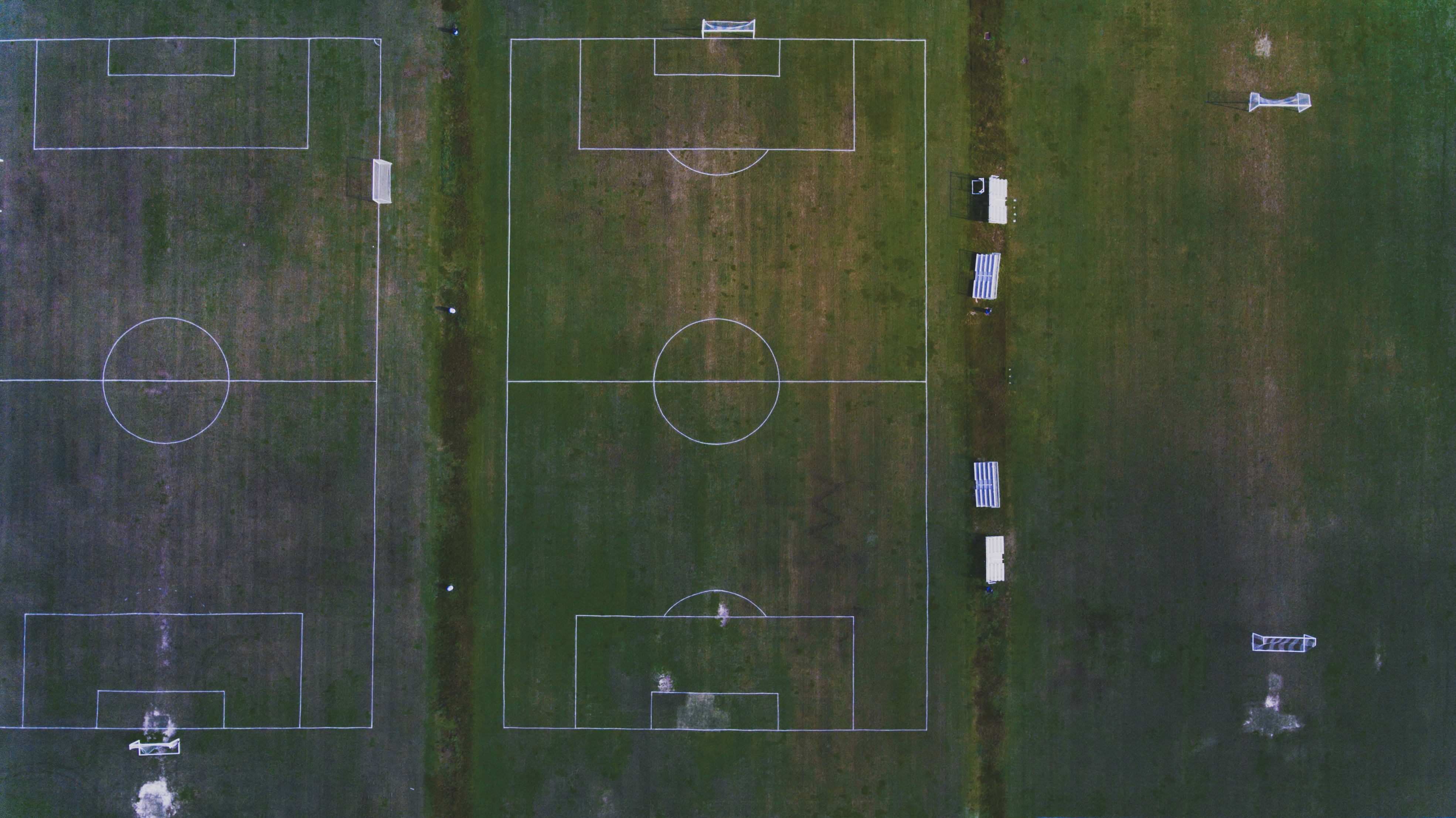 birds eye photography of two soccer fields