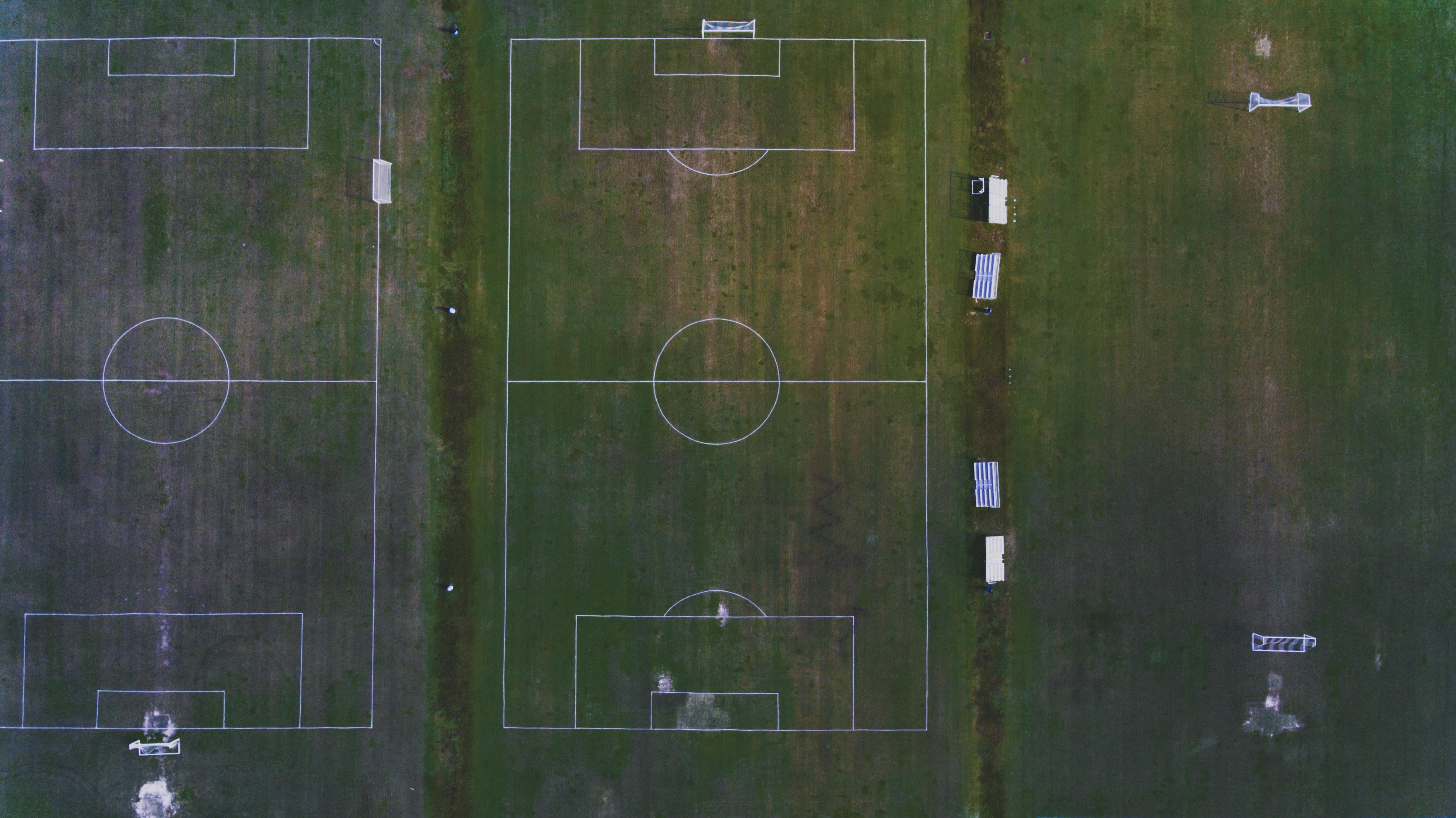 birds eye photography of two soccer fields