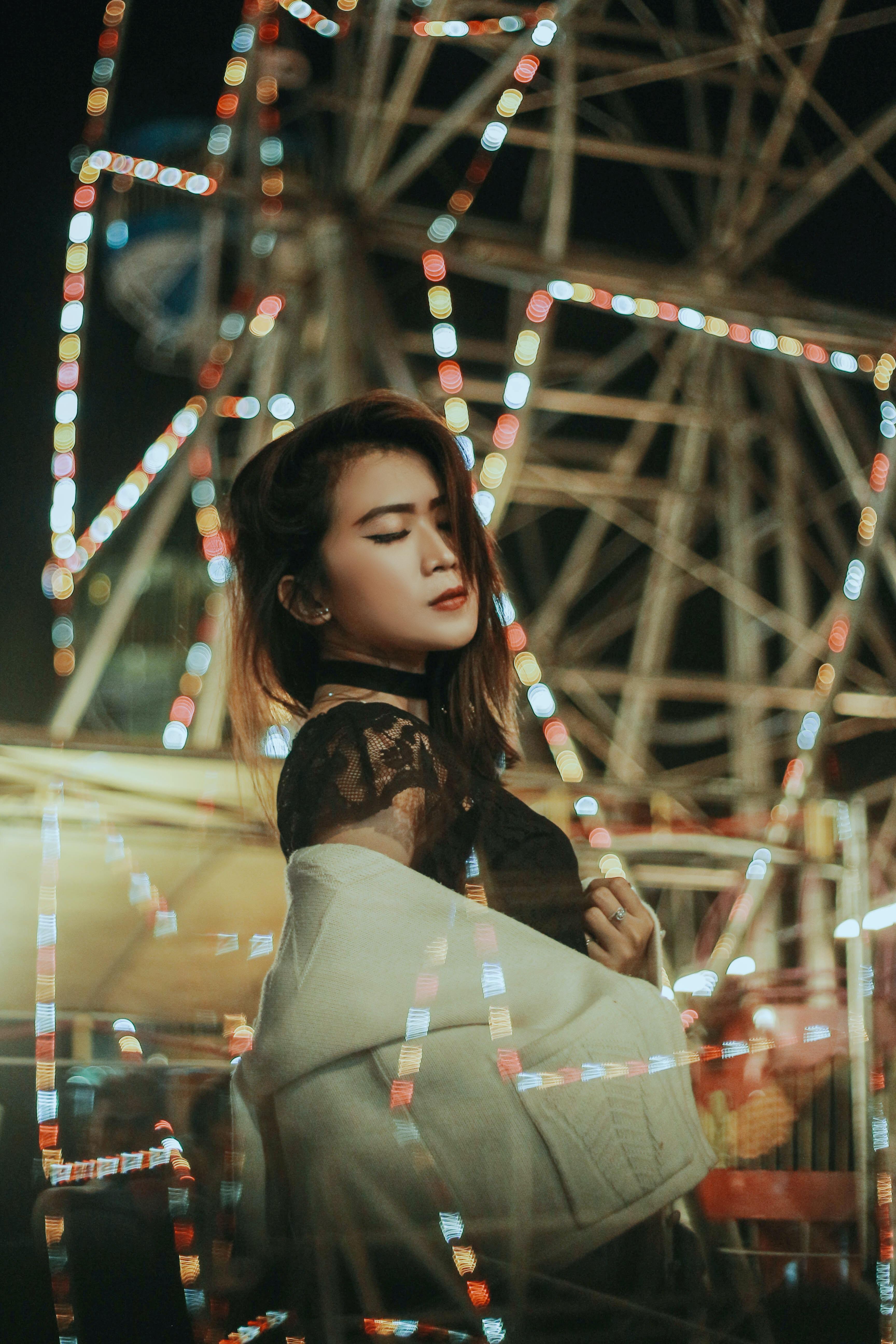 woman in front of ferris wheel
