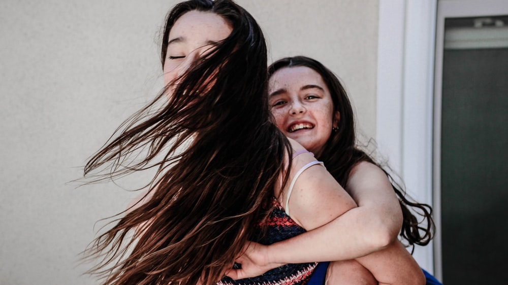 woman carryin girl on her back