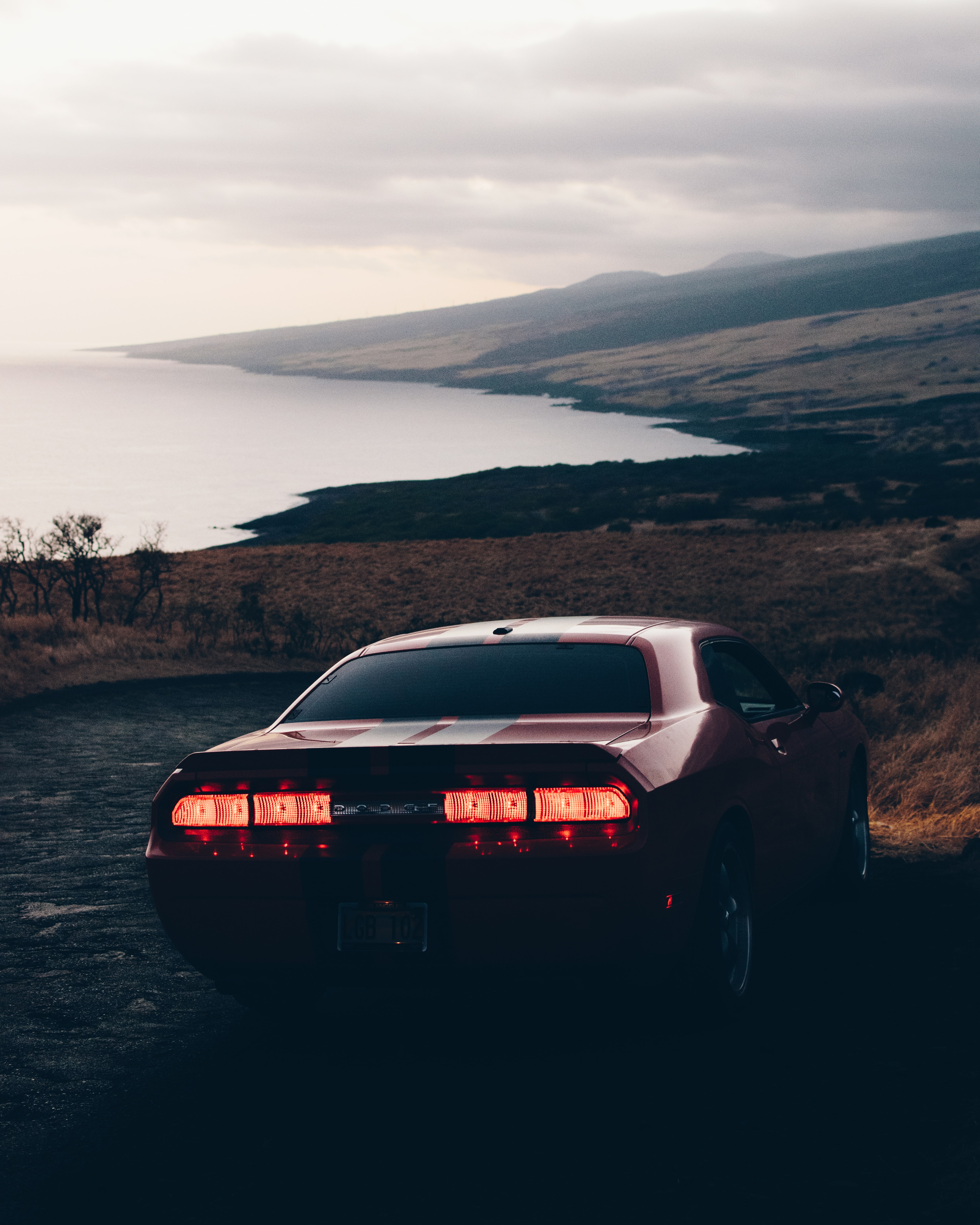 red Dodge Challenger coupe on cliff