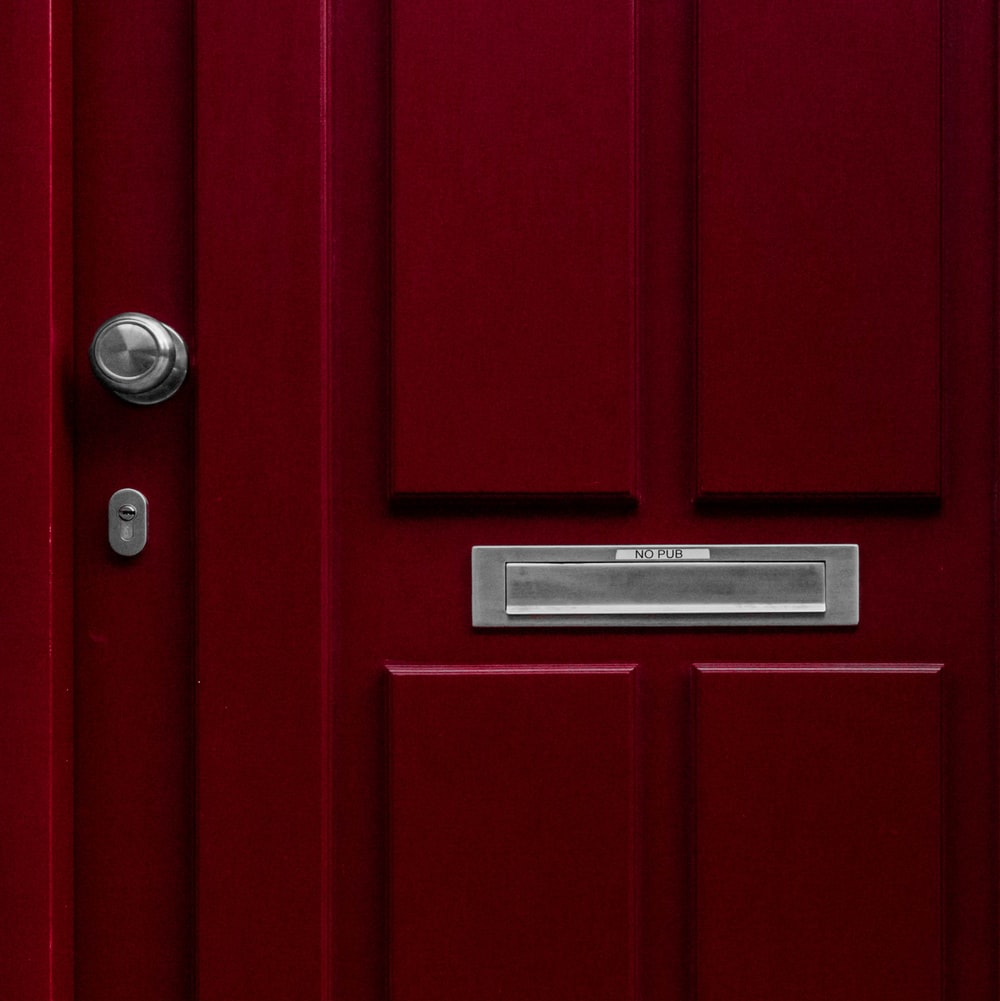 red wooden door with mail box
