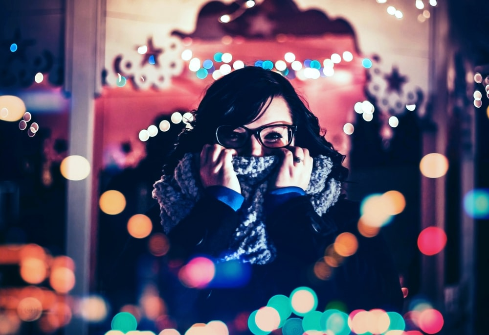 woman covered her face with scarf photo with bokeh background