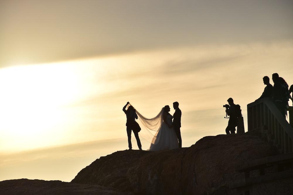 wedded couple on boulder
