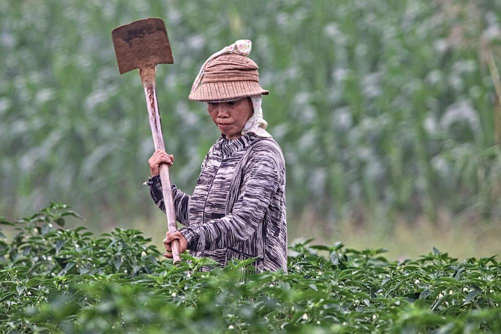 woman holding gardening tool