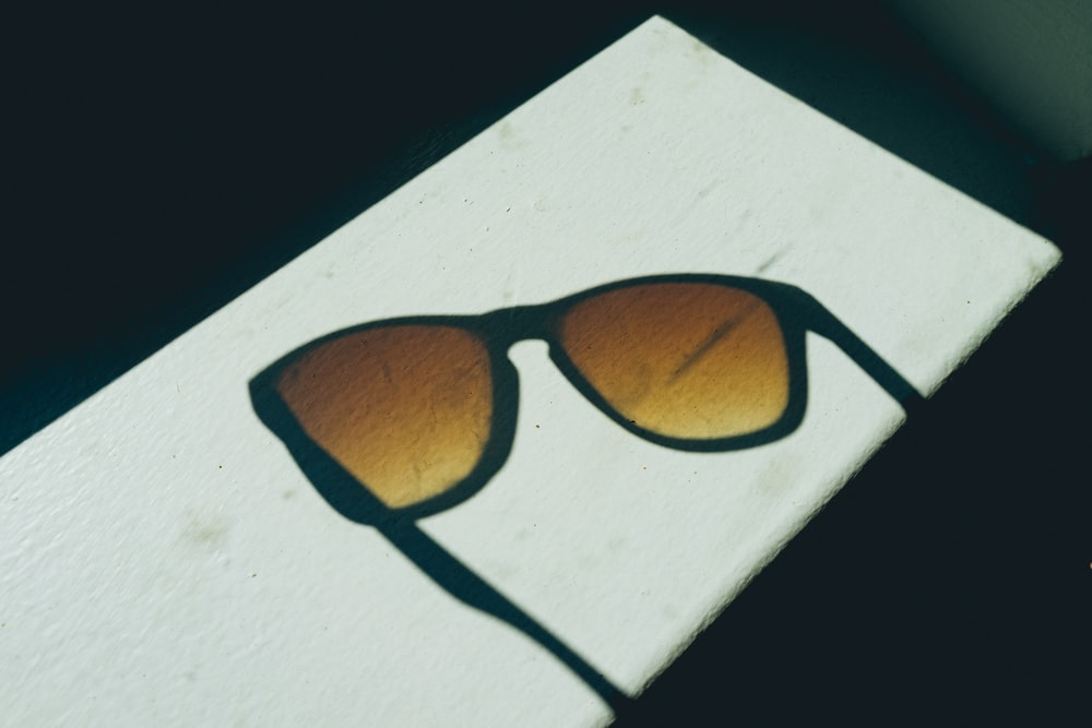 sunglasses on white surface