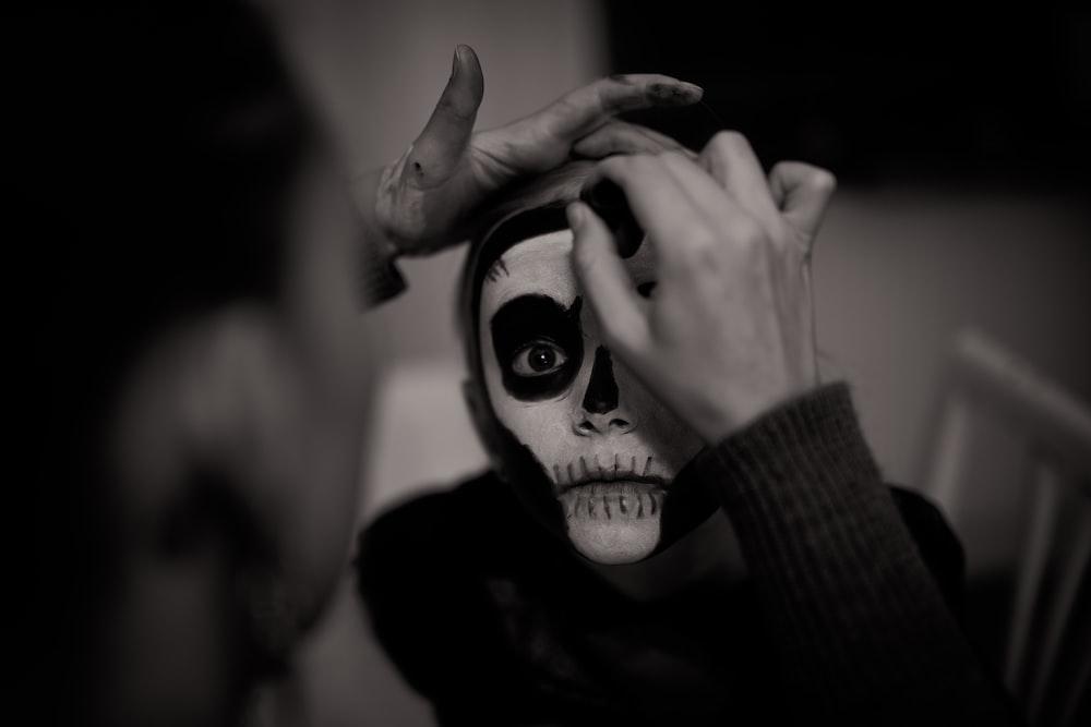 fan doing face skull makeup
