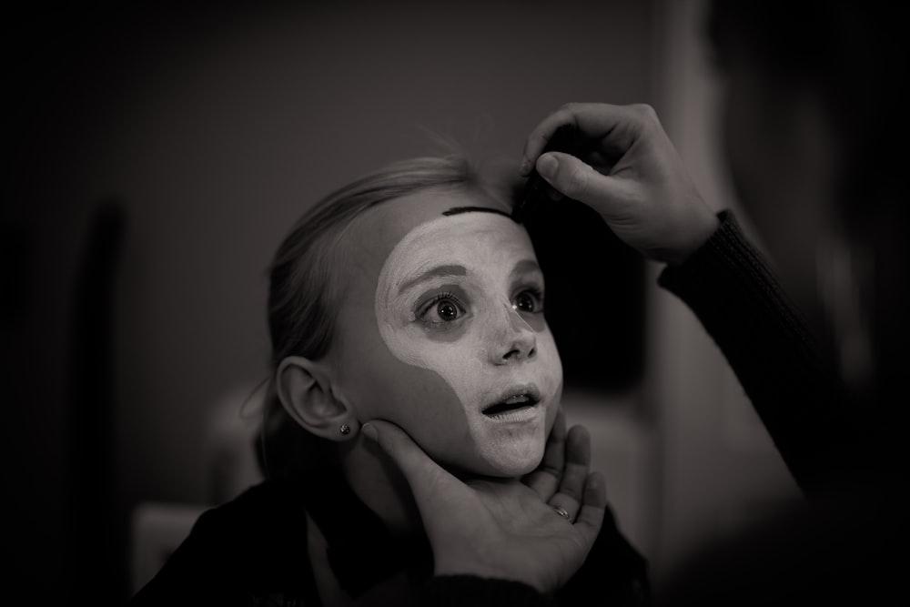 girl's face covered in white cream