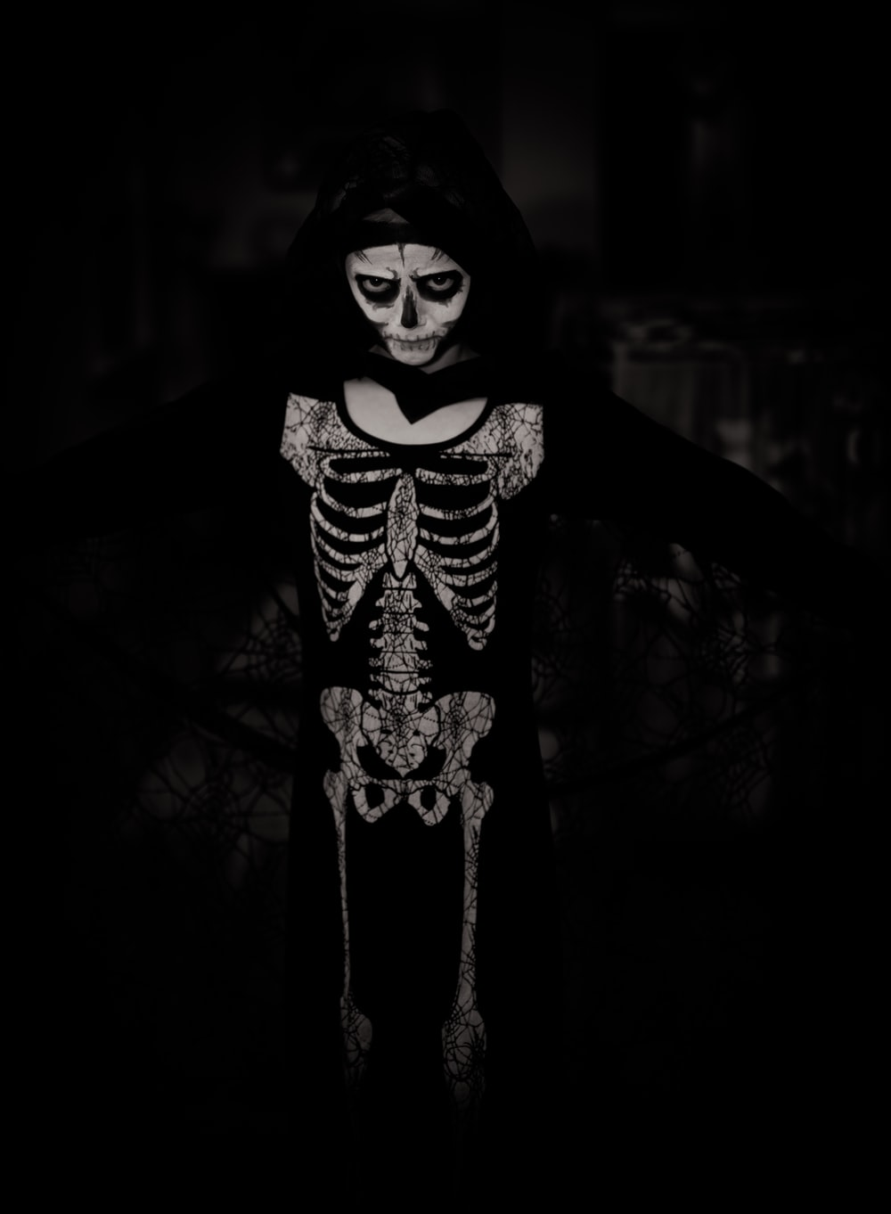 person wearing skeleton costume