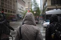 person walking in pedestrian lane