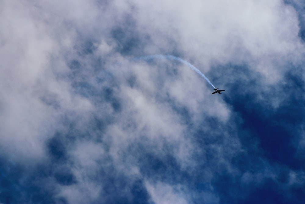 plane flying near clouds